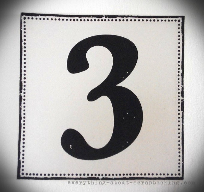 A canvas art print featuring a big number 3.