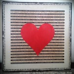 DIY canvas art print featuring a big red heart shape on scrapbook paper.