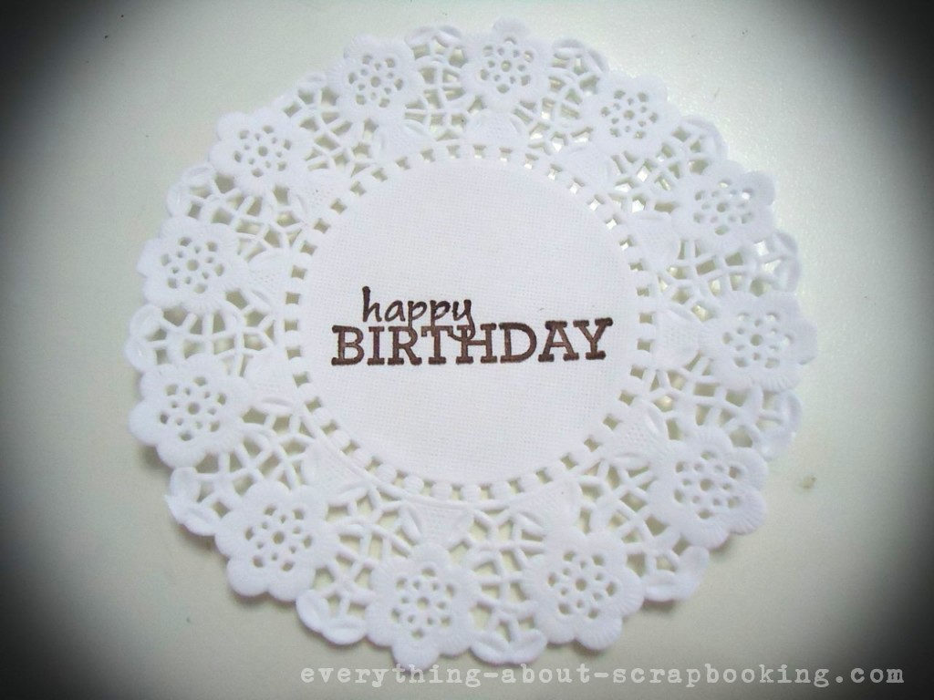 Rubber stamping text on a piece of doily.